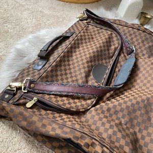 Brown checkered vintage garment bag for travel
